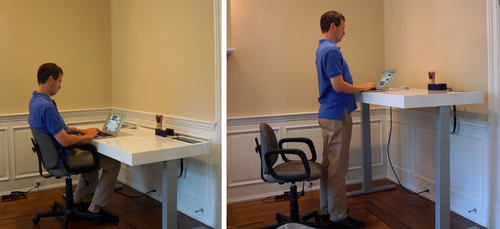 David Pogue sitting and standing at the Stir desk