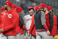 Cincinnati Reds starting pitcher Wade Miley, center, smiles as teammates congratulate him after he pitched a no-hitter in a baseball game against the Cleveland Indians, Friday, May 7, 2021, in Cleveland. (AP Photo/Tony Dejak)