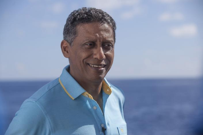 In this Saturday, April 13, 2019, photo, Seychelles President Danny Faure smiles during an interview with the Associated Press, on board the vessel Ocean Zephyr off the coast of Desroches, in the outer islands of Seychelles. President Faure was visiting a British-led science expedition exploring the depths of the Indian Ocean where scientists documented changes taking place beneath the waves that could affect billions of people in the surrounding region over the coming decades. (AP Photo/Steve Barker)