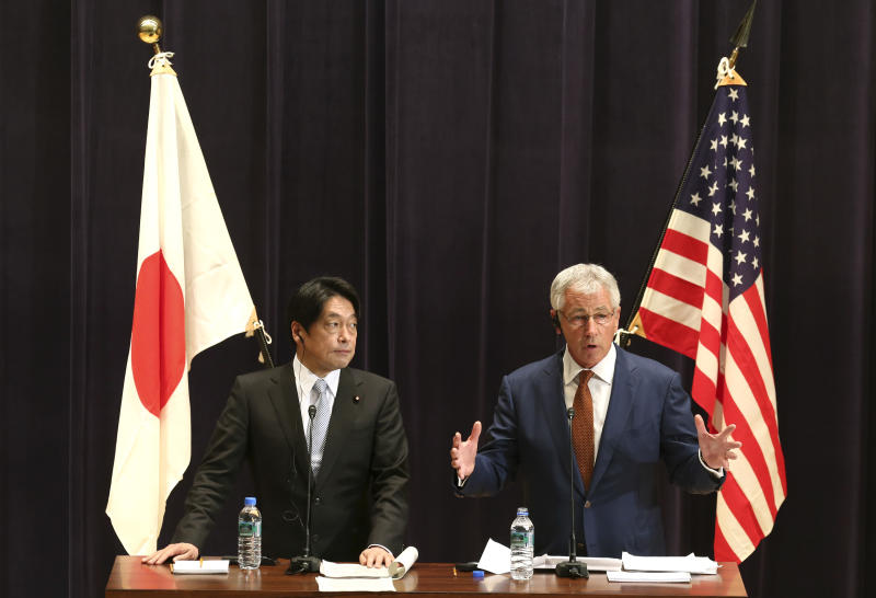 U.S. Secretary of Defense Chuck Hagel, right, answers a question from a journalist as his Japanese counterpart Itsunori Onodera listens during their joint press conference in Tokyo, Sunday, April 6, 2014. The U.S. will deploy two additional ballistic missile defense destroyers to Japan by 2017 as part of an effort to bolster protection from North Korean missile threats, Hagel said Sunday. (AP Photo/Eugene Hoshiko)