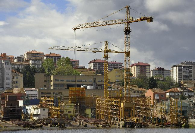 Cranes stand idle at an empty shipyard in Vigo due to a loss of orders on April 27, 2012