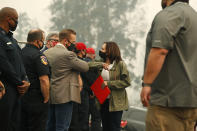 Democratic vice presidential candidate Sen. Kamala Harris, D-Calif., bumps elbows with Fresno County Board of Supervisor, Nathan Magsig, before she was briefed on the Creek Fire at Pine Ridge Elementary, Tuesday, Sept. 15, 2020 in Auberry, Calif. (AP Photo/Gary Kazanjian)