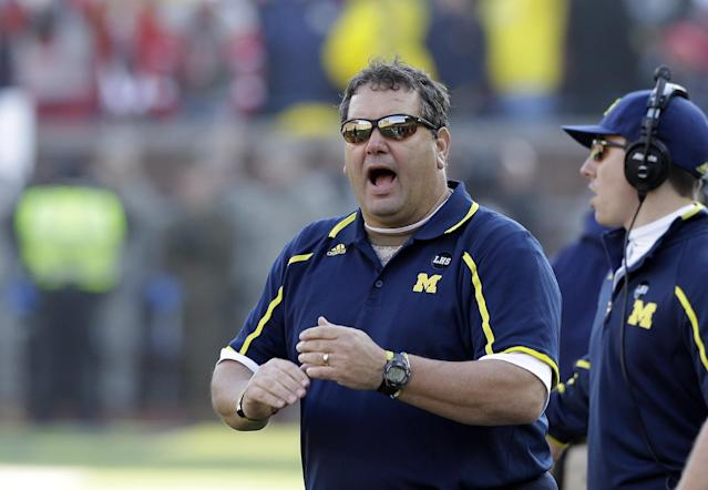 Michigan head coach Brady Hoke is seen during the second half of an NCAA college football game against Ohio State in Ann Arbor, Mich., Saturday, Nov. 30, 2013. (AP Photo/Carlos Osorio)