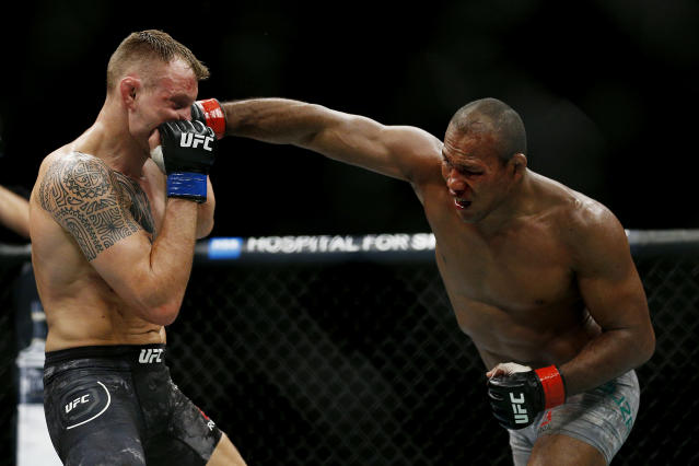 "Ronaldo ""Jacare"" Souza punches Jack Hermansson during their middleweight bout at UFC Fight Night at BB&T Center on April 27, 2019 in Sunrise, Florida. (Photo by Michael Reaves/Getty Images)"