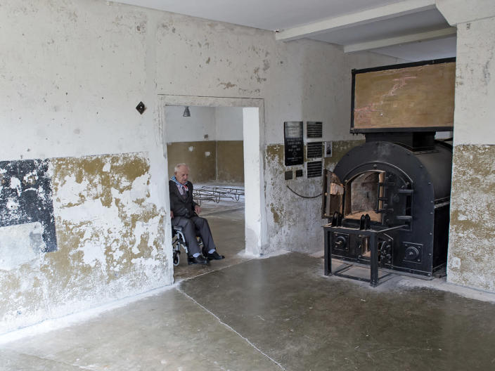 <p>Nazi concentration camp survivor Marian Wach of Poland enters the crematory during the commemoration ceremonies for the 72th anniversary of the liberation of former Nazi concentration camp Mittelbau-Dora near Nordhausen, central Germany, Monday, April 10, 2017. (Photo: Jens Meyer/AP) </p>
