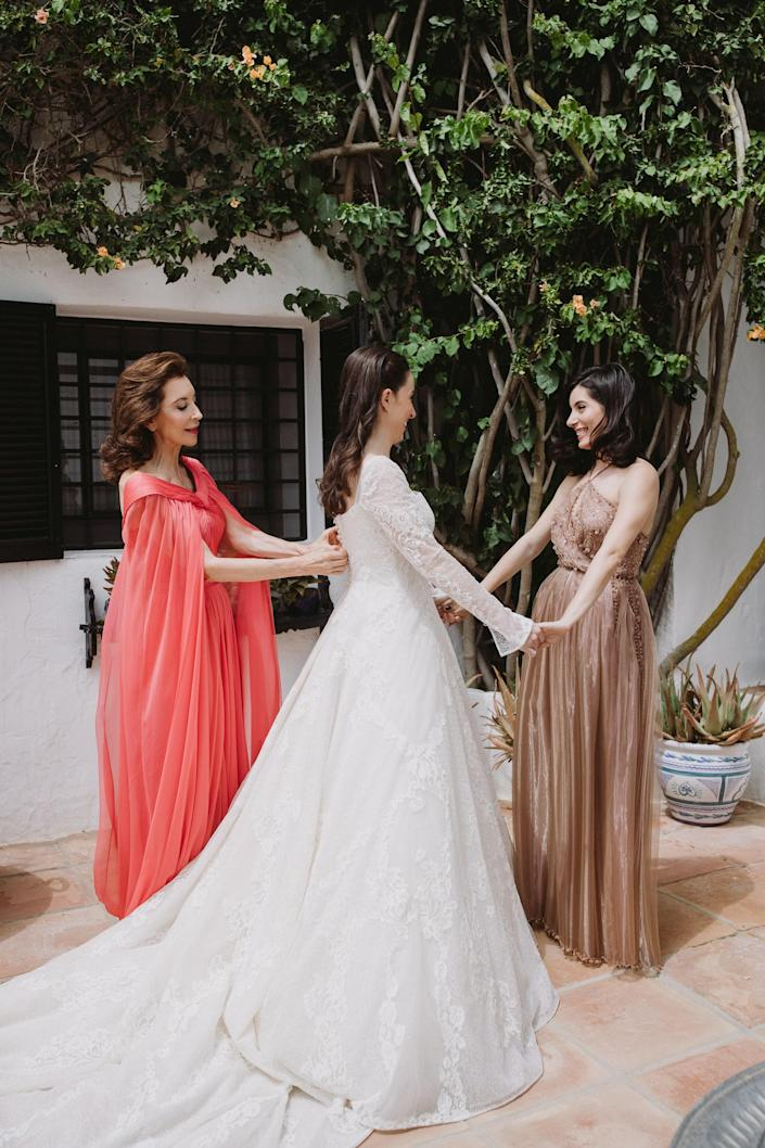 My mother and my sister helping me with my dress.