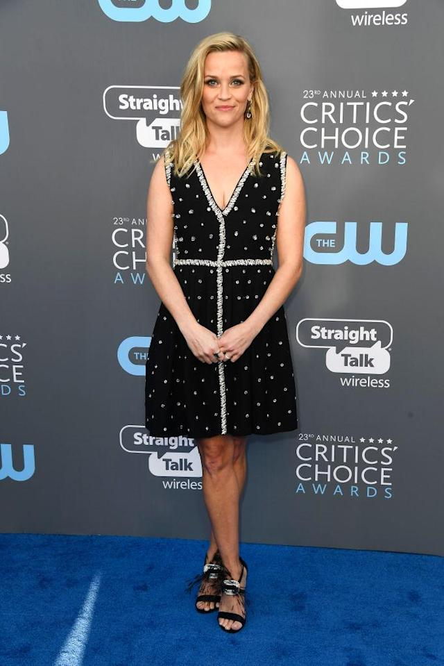 <p>Witherspoon accessorized her minidress with sapphire jewels. (Photo: Getty Images) </p>