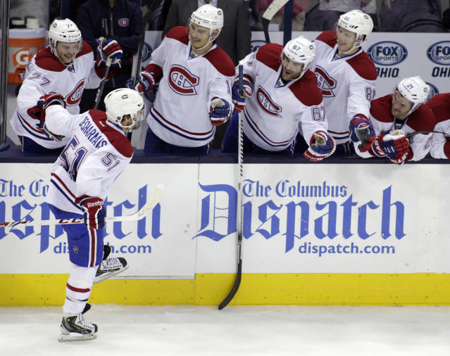 Montreal Canadiens' David Desharnais (51) celebrates his shoot out goal against the Columbus Blue Jackets during the third period of an NHL hockey game Friday, Nov. 15, 2013, in Columbus, Ohio. The Canadiens beat the Blue Jackets 3-2. (AP Photo/Jay LaPrete)