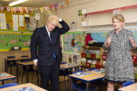 Britain's Prime Minister Boris Johnson talks to head teacher Bernadette Matthews during his visit to St Joseph's Catholic Primary School, London, Monday Aug. 10, 2020, to see the steps they are taking to be COVID secure ahead of children returning in September. (Lucy Young/Pool via AP)