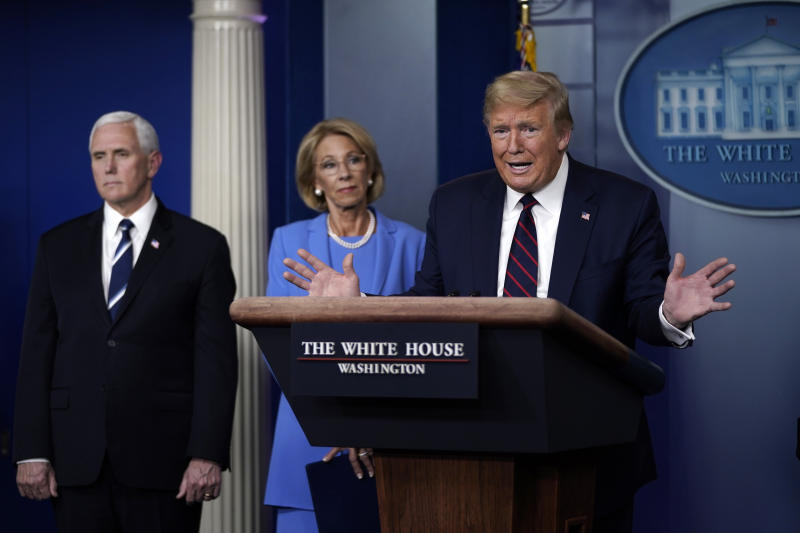 WASHINGTON, DC - MARCH 27: U.S. President Donald Trump speaks as Vice President Secretary of Education Betsy DeVos and Secretary of Agriculture Sonny Perdue look on during a briefing on the coronavirus pandemic in the press briefing room of the White House on March 27, 2020 in Washington, DC. President Trump signed the H.R. 748, the CARES Act on Friday afternoon. Earlier in the day, the U.S. House of Representatives approved the $2 trillion stimulus bill that lawmakers hope will battle the economic effects of the COVID-19 pandemic. (Photo by Drew Angerer/Getty Images)
