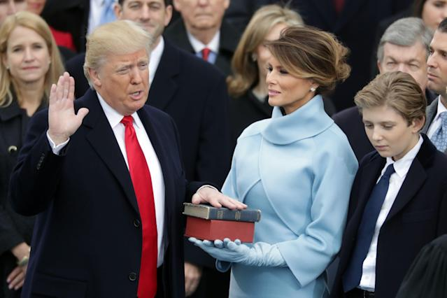 """<p>On Inauguration Day, Melania stepped out in a slim-fitting powder blue suit and suede gloves <a href=""""http://www.townandcountrymag.com/society/politics/news/a9292/what-trump-family-melania-wore-to-the-inauguration/"""" rel=""""nofollow noopener"""" target=""""_blank"""" data-ylk=""""slk:reminiscent of what Jackie Kennedy wore to JFK's"""" class=""""link rapid-noclick-resp"""">reminiscent of what Jackie Kennedy wore to JFK's</a> swearing in ceremony in 1961.</p>"""