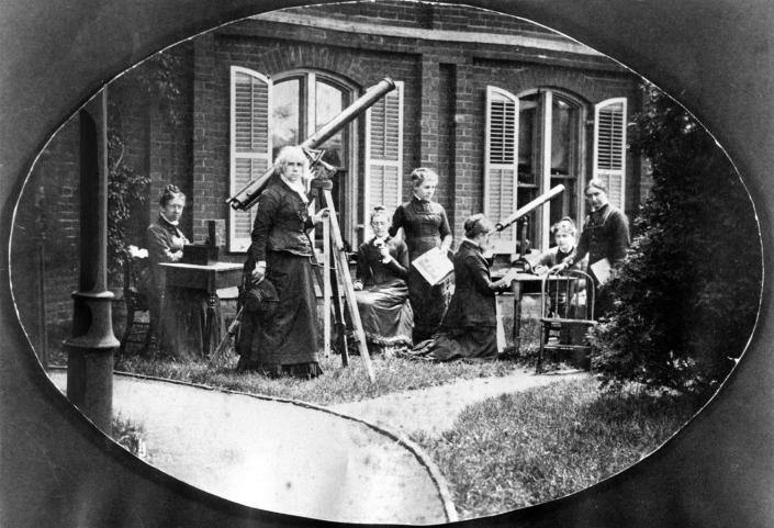 <p>Astronomer Maria Mitchell (1818-1889), standing second from left, next to a telescope, is shown with her astronomy class outside the observatory, at Vassar College, Poughkeepsie, N.Y., circa 1870. (Photo: Interim Archives/Getty Images) </p>
