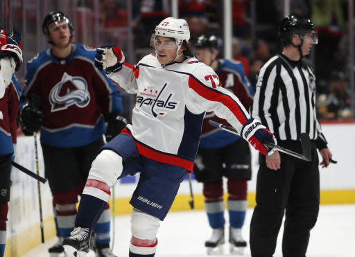 Washington Capitals right wing T.J. Oshie celebrates as he passes the team box after scoring the go-ahead goal against the Colorado Avalanche during the third period of an NHL hockey game Thursday, Feb. 13, 2020, in Denver. The Capitals won 3-2. (AP Photo/David Zalubowski)