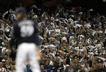 A raucous crowd in Milwaukee stayed engaged through the ninth inning, when John Axford got the final outs in a 9-4 win