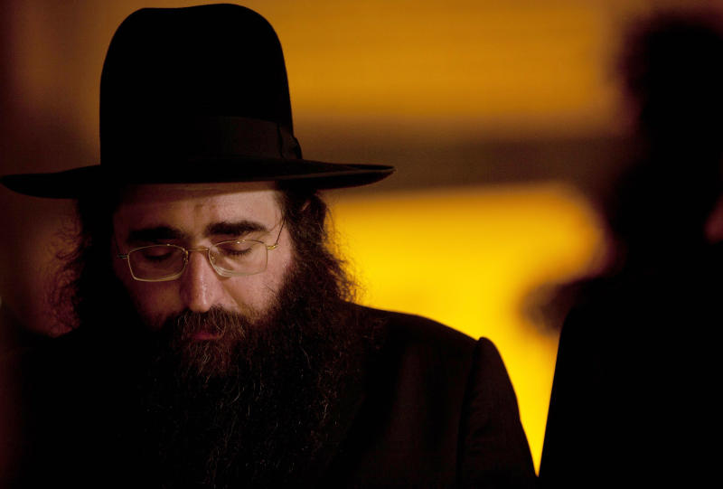 In this July 11, 2011 file photo, Rabbi Yoshiyahu Pinto attends a wedding in Lod, central Israel. In the fall of 2009, when future U.S. Rep. Michael Grimm announced his run for congress, he sorely needed a rainmaker who could get the dollars flowing to his nascent campaign. He found one in an Israeli Rabbi Pinto, but now that fruitful association has turned into a big headache for the Staten Island Republican - one involving allegations of illegal donations, a bizarre blackmail claim and potentially embarrassing associations with people in the pornography business. (AP Photo/Oded Balilty, File)