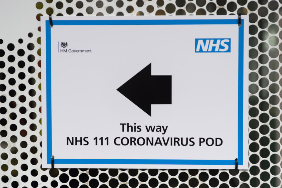LONDON, March 2, 2020 -- Photo taken on March 2, 2020 shows a sign directing patients to a National Health Service 111 Coronavirus Pod positioned at the University College Hospital in London, Britain. (Photo by Ray Tang/Xinhua via Getty) (Xinhua/Ray Tang via Getty Images)