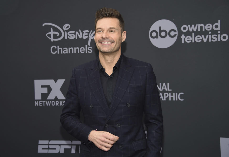 "FILE - In this May 14, 2019 file photo, Ryan Seacrest attends the Walt Disney Television 2019 upfront in New York. Most folks have slowed down in the past nine months but Seacrest says he's been juggling more than normal during the pandemic. This week, he will return to New York's Times Square to host ""Dick Clark New Year's Rockin' Eve."" The broadcast will be closed to the public except for a small group of front line workers. (Photo by Evan Agostini/Invision/AP, File)"