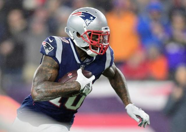 Josh Gordon, on the way to a touchdown for New England against Minnesota on December 2, 2018, has been conditionally reinstated in the wake of his suspension for violating the NFL's substance abuse policy (AFP Photo/Billie Weiss)