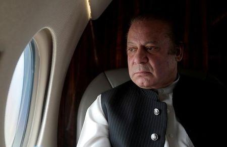 FILE PHOTO: Pakistani Prime Minister Nawaz Sharif looks out the window of his plane after attending a ceremony to inaugurate the M9 motorway between Karachi and Hyderabad, Pakistan February 3, 2017. REUTERS/Caren Firouz/File Photo