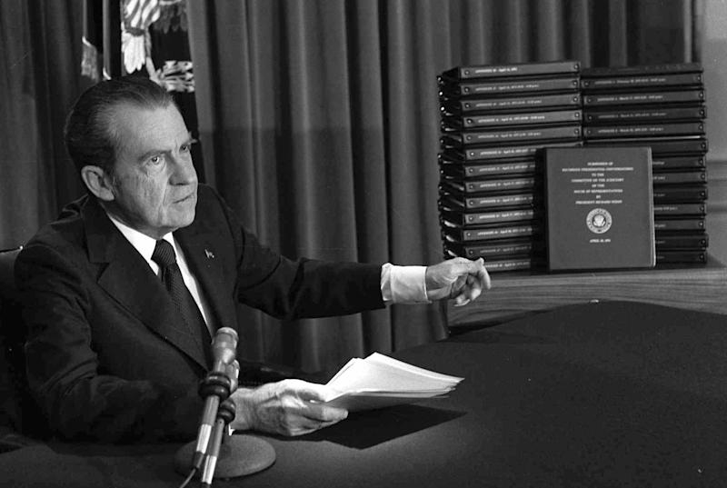 President Richard M. Nixon points to the transcripts of White House tapes after he announced during a nationally-televised speech on April 29, 1974, that he would turn over the documents to House impeachment investigators. He resigned less than four months later to avoid almost certain impeachment.
