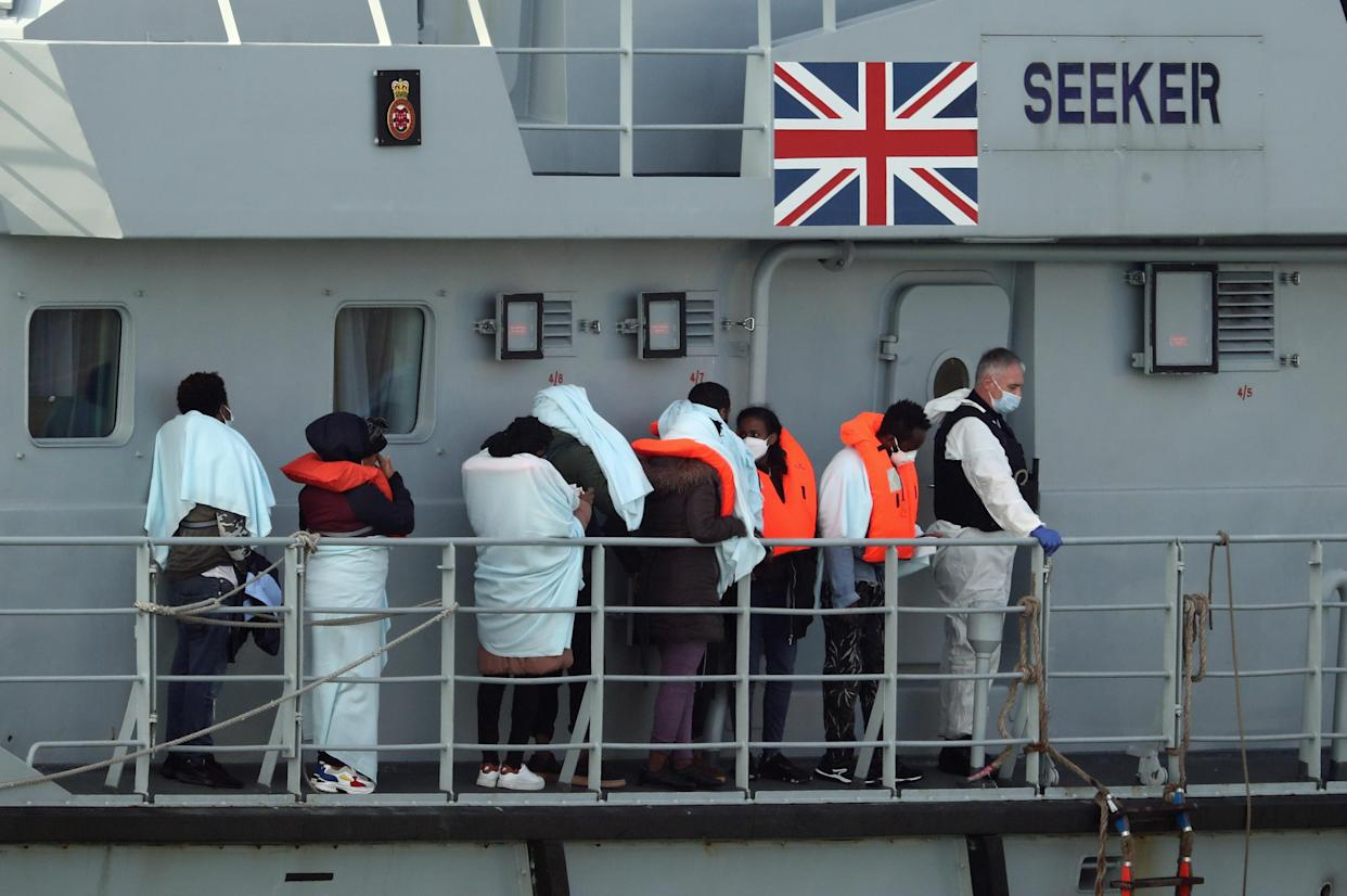 A group of people thought to be migrants on the deck of HMC Seeker, queue to be brought ashore in Dover last year. (PA)