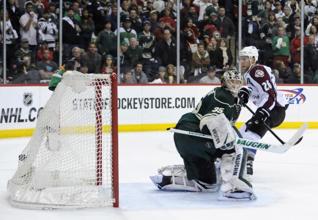ST PAUL, MN - APRIL 28: Paul Stastny #26 of the Colorado Avalanche scores a goal shorthanded as Darcy Kuemper #35 of the Minnesota Wild watches the puck hit the back of the net during the first period in Game Six of the First Round of the 2014 NHL Stanley Cup Playoffs on April 28, 2014 at Xcel Energy Center in St Paul, Minnesota. (Photo by Hannah Foslien/Getty Images)