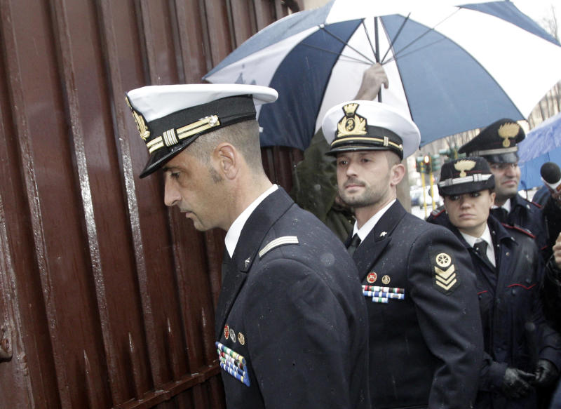 Italian marines Massimiliano Latorre, left, and Salvatore Girone arrive at the military prosecutor's office in Rome Wednesday, March 20, 2013. A military prosecutor in Rome is questioning the two Italian marines India is insisting return to face trial in the deaths of two fishermen. India's Supreme Court barred the Italian ambassador from leaving the country after the Italian government refused to return the marines to India. The two have been charged in India with killing two Indian fishermen whom the marines say they mistook for pirates. (AP Photo/Riccardo De Luca)