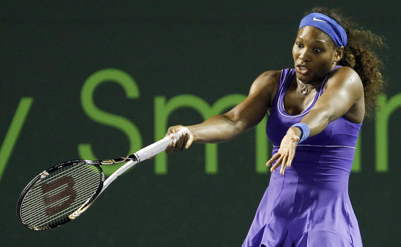 Serena Williams, of the United States, reacts after losing a point to Caroline Wozniacki, of Denmark, during the Sony Ericsson Open tennis tournament in Key Biscayne, Fla., Tuesday, March 27, 2012. Wozniacki won 6-4, 6-4. (AP Photo/Alan Diaz)