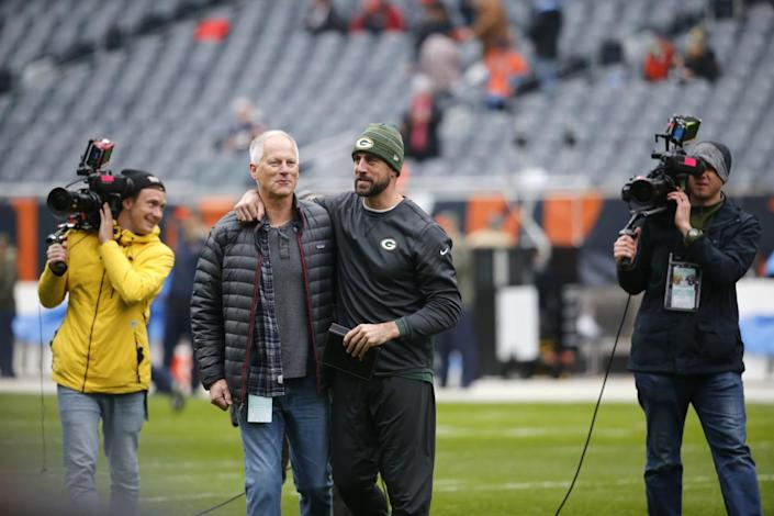 Green Bay Packers quarterback Aaron Rodgers, right, talk to ESPN's Kenny Mayne.