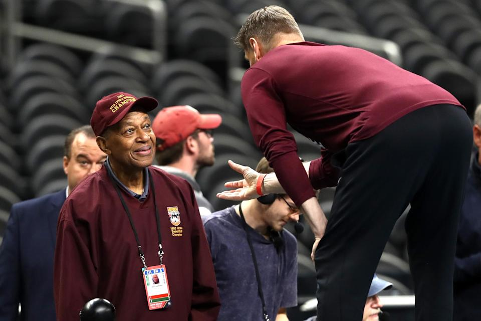 Head coach Porter Moser of the Loyola Ramblers speaks to former Loyola player Jerry Harkness during practice before the 2018 Men's NCAA Final Four at the Alamodome on March 30, 2018 in San Antonio, Texas. (Ronald Martinez/Getty Images)