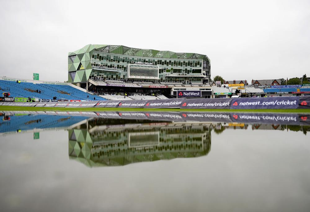 LEEDS, ENGLAND - SEPTEMBER 06:  A reflection of the Carnegie Pavilion on a rain delayed day at Headingley Carnegie Stadium on September 6, 2013 in Leeds, England.  (Photo by Laurence Griffiths/Getty Images)