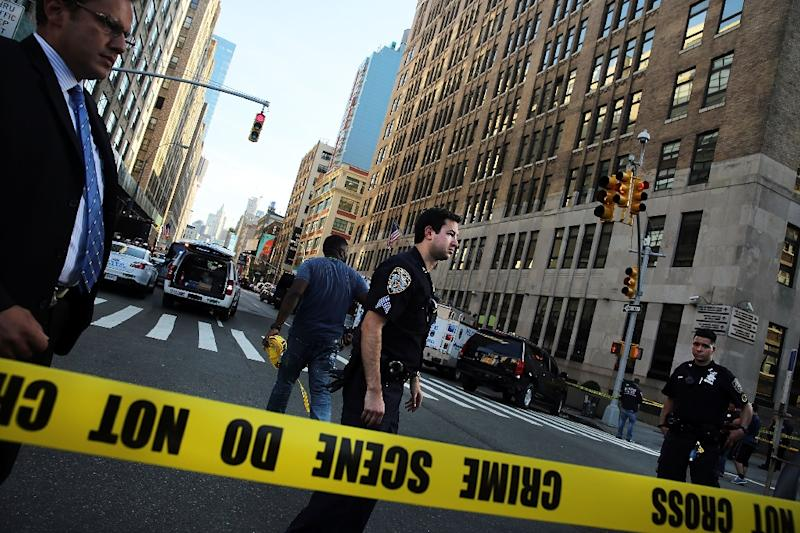 Police cordon off the scene in lower Manhattan where two people were shot at the Federal Immigration Court on August 21, 2015 in New York City (AFP Photo/Spencer Platt)