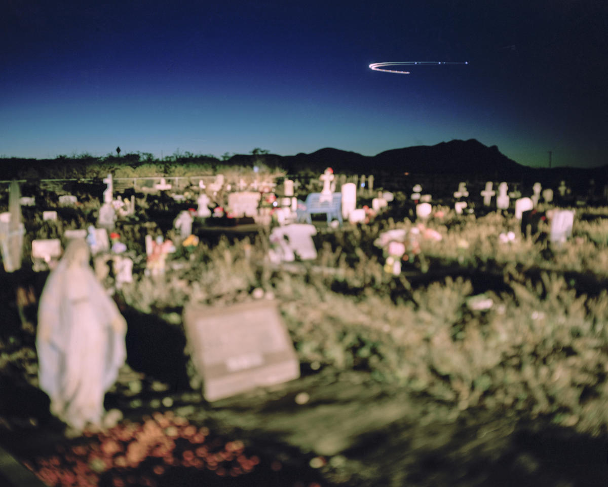 "<p>""Acknowledgment of Danger"": Luis Lopez Cemetery, Socorro County, N.M., April 2, 2016. Luis Lopez is a town in one of four counties being studied for health impacts resulting from radiation fallout from the 1945 Trinity atomic test. Unlike residents of Nevada and Utah, those in New Mexico have never been acknowledged or covered under the Radiation Exposure Compensation Act. Luis Lopez residents say dozens of people in the cemetery died of cancer and wonder if it was linked to the Trinity test. Residents within 150 miles of the Trinity site show higher incidents of cancer than in other parts of New Mexico, according to a health impact study released in 2017 by the Tularosa Basin Downwinders Consortium. (© Nina Berman from ""War Is Only Half the Story,"" the Aftermath Project & Dewi Lewis Publishing) </p>"