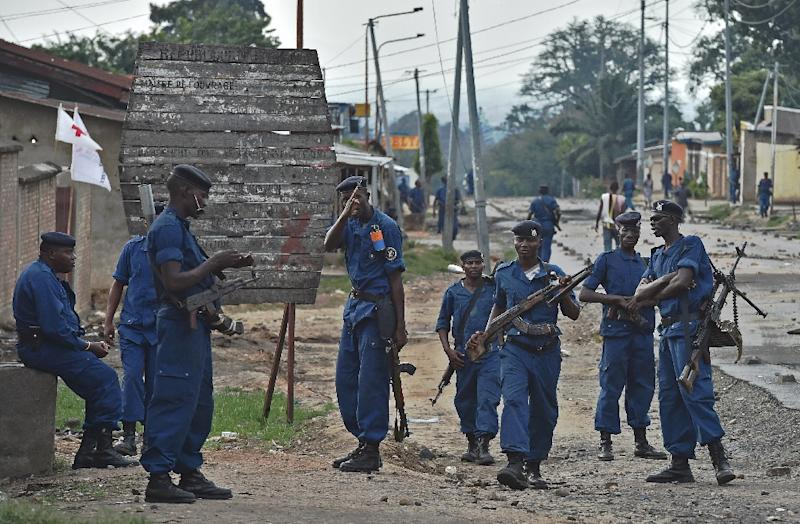 Policemen patrol the Musaga neighborhood of Burundi's capital city, Bujumbura, in May 2015; Canada said on December 2 it is no longer deporting Burundi nationals lacking proper papers, lest they face violence at home amid continuing political unrest