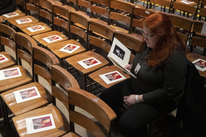 A woman looks through the program before the start of the Celebration of the Life of Toni Morrison, Thursday, Nov. 21, 2019, at the Cathedral of St. John the Divine in New York. (AP Photo/Mary Altaffer)