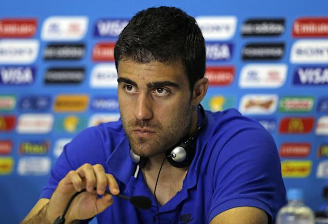 Greece's Sokratis Papastathopoulos speaks during a press conference of Greece in Natal, Brazil, Wednesday, June 18, 2014. Greece play in group C of the 2014 soccer World Cup. (AP Photo/Shuji Kajiyama)