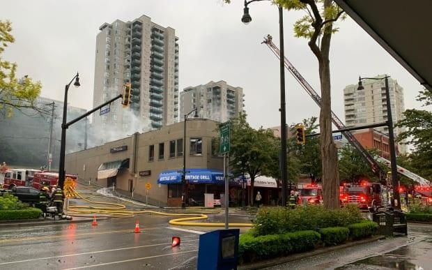 The fire caused the the roof of the commercial building, which was said to be more than 100 years old, to collapse. (Yvette Brend/CBC News - image credit)