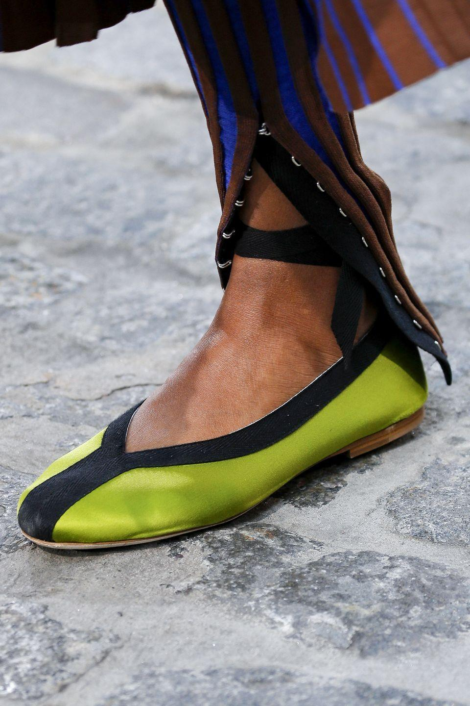 <p>Elevated takes on the ballet flat showed up on the runway in neon hues with modern details, like strappy details. </p>