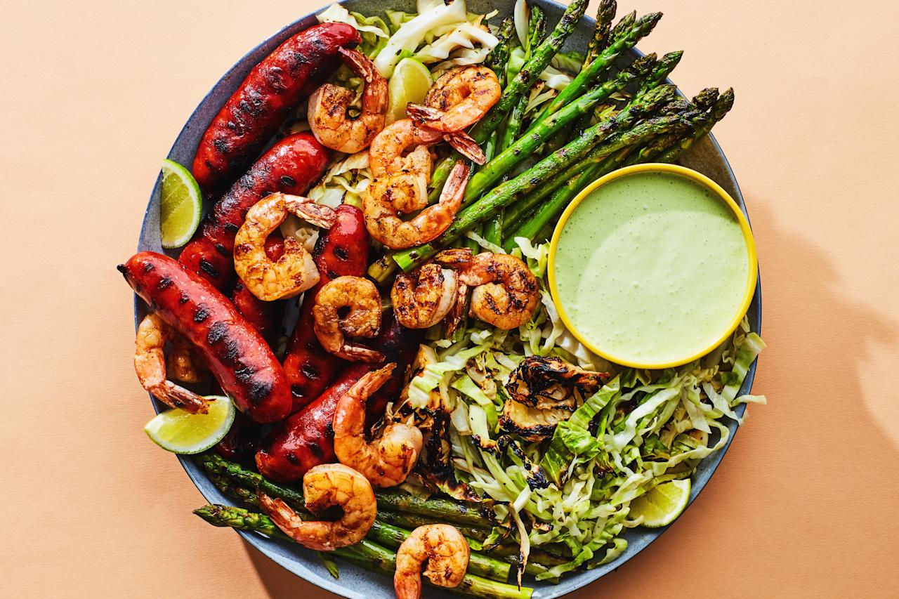 """This crowd-pleasing surf-and-turf dinner features lots of fresh asparagus, making it just the thing for your early summer cookout. <a href=""""https://www.epicurious.com/recipes/food/views/shrimp-and-chorizo-mixed-grill?mbid=synd_yahoo_rss"""">See recipe.</a>"""