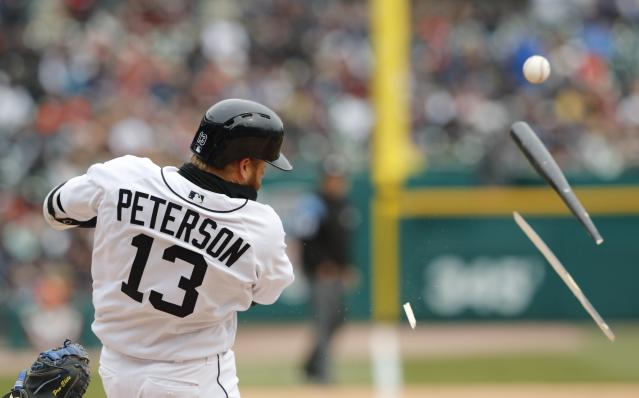Detroit Tigers' Dustin Peterson breaks his bat during the seventh inning of a baseball game against the Kansas City Royals, Thursday, April 4, 2019, in Detroit. (AP Photo/Carlos Osorio)