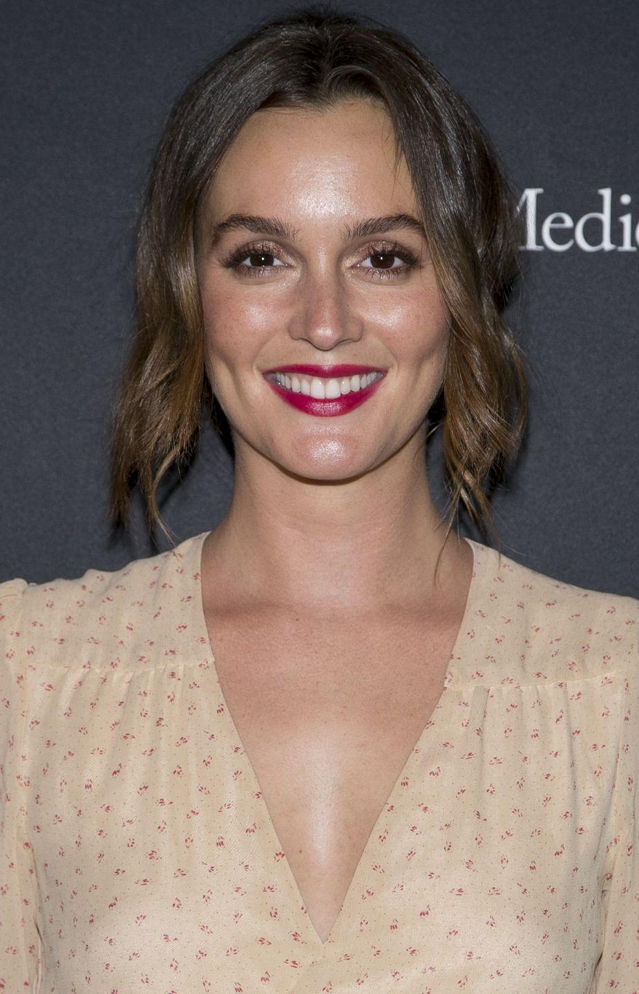 """<p>Subtle chestnut ombré locks look beautiful in a simple <a href=""""https://www.goodhousekeeping.com/beauty/hair/tips/g1800/celebrity-hairstyles-updo/"""" rel=""""nofollow noopener"""" target=""""_blank"""" data-ylk=""""slk:updo"""" class=""""link rapid-noclick-resp"""">updo</a>. Take a cue from <strong>Leighton Meester</strong> and leave the front pieces out in loose curls.</p>"""