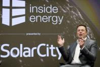 FILE PHOTO: Elon Musk, Chairman of SolarCity and CEO of Tesla Motors, speaks at SolarCityÕs Inside Energy Summit in Midtown, New York