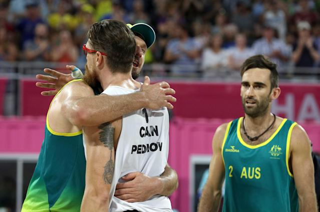 Beach Volleyball - Gold Coast 2018 Commonwealth Games - Men's Gold Medal Match - Australia v Canada - Coolangatta Beachfront - Gold Coast, Australia - April 12, 2018. Samuel Pedlow of Canada congratulates gold medalist Damien Schumann and Christopher McHugh of Australia. REUTERS/Athit Perawongmetha