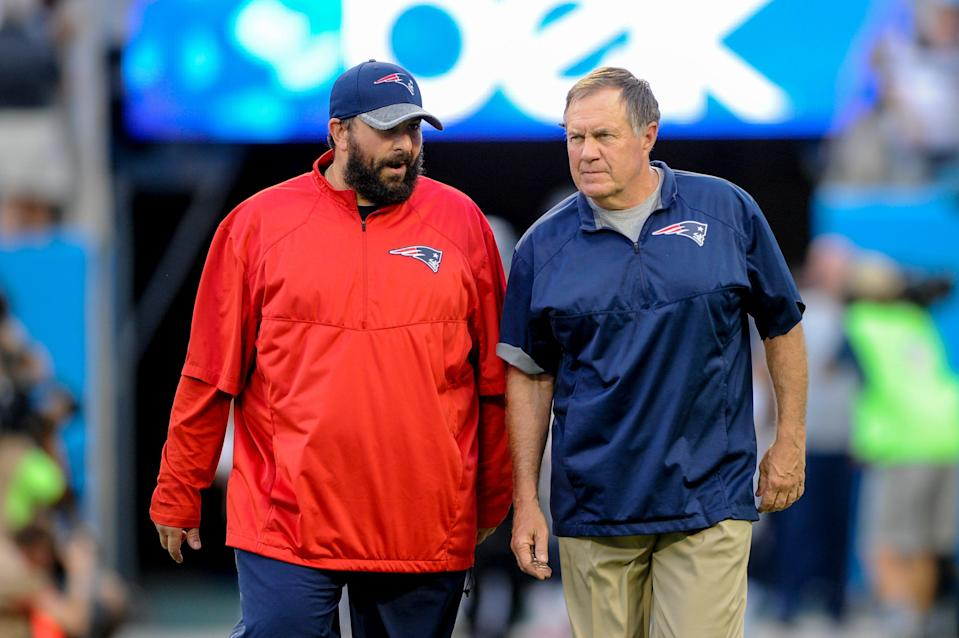 FILE - In this Aug. 26, 2016, file photo, New England Patriots defensive coordinator Matt Patricia, left, talks with head coach Bill Belichick prior to the start of an NFL football game against the Carolina Panthers in Charlotte, N.C. Patricia is in his second year as head coach of the Detroit Lions. While Belichick owns a record six Super Bowl championship rings, his former New England assistants have combined for one playoff victory as head coaches. (AP Photo/Mike McCarn, File)