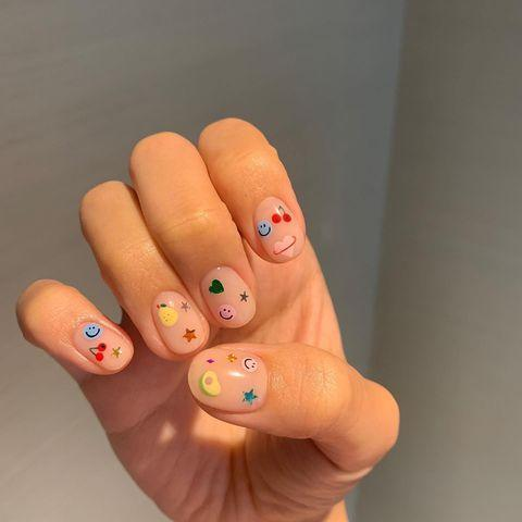 "<p>Hark back to your school days with a nostalgic sticker book nail art design.</p><p><a href=""https://www.instagram.com/p/CA2ea0_BEW7/?utm_source=ig_embed&utm_campaign=loading"" rel=""nofollow noopener"" target=""_blank"" data-ylk=""slk:See the original post on Instagram"" class=""link rapid-noclick-resp"">See the original post on Instagram</a></p>"