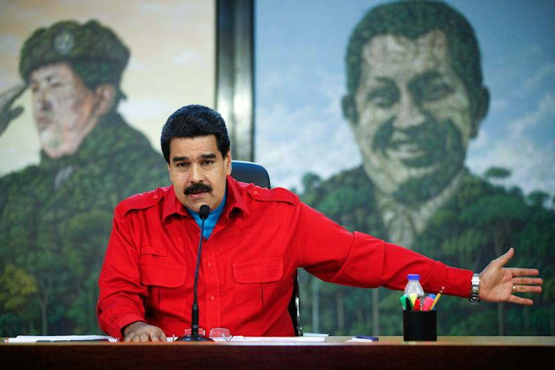 Venezuelan President Nicolas Maduro speaks during the broadcast of a TV programme at the Miraflores presidential palace in Caracas on December 11, 2014 in this photo from the Presidencia