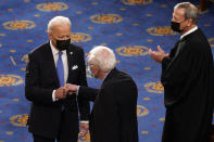 President Joe Biden greets Sen. Bernie Sanders, I-Vt., as Chief Justice of the United States John Roberts watches as Biden arrives to speak to a joint session of Congress Wednesday, April 28, 2021, in the House Chamber at the U.S. Capitol in Washington. (AP Photo/Andrew Harnik, Pool)