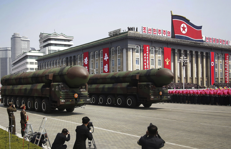 North Korea parades missiles during a parade in Pyongyang (Picture: REX)