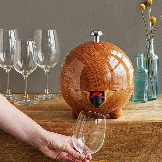 """<p>This classy wood grained-inspired <span>""""Wine Dispensing Sphere</span> ($65) is for the hostess with the mostest. </p>"""