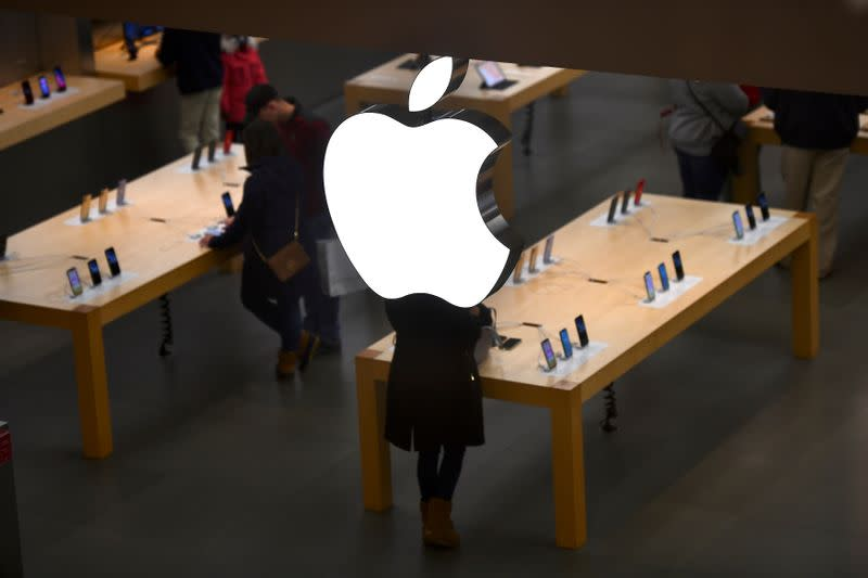 FILE PHOTO: An Apple logo is seen at an Apple store as pre-Thanksgiving and Christmas holiday shopping accelerates at the King of Prussia Mall in King of Prussia